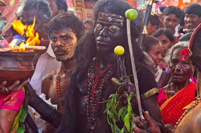 Dasara festival in India: person dressed as Goddess Kali, the black Goddes of death, in the crowded street by Kris Hariharan.