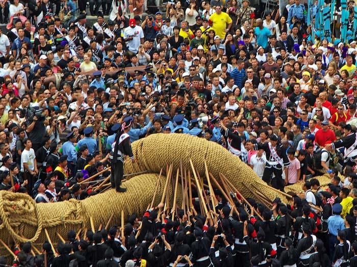 Photo of crowd & 40 ton tug-o-war rope at Naha Matsuri Festival in Naha Okinawa, Japan by Michael Lynch