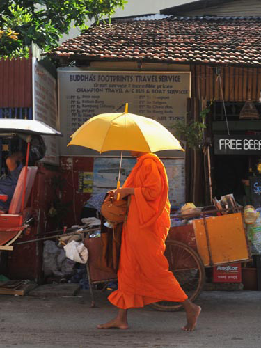 Photo of Monk in Bangkok, Thailand by Ron Veto