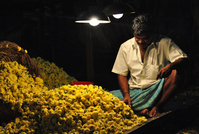 Photo of man selling flowers in India by Shilpa Reddy Perugu