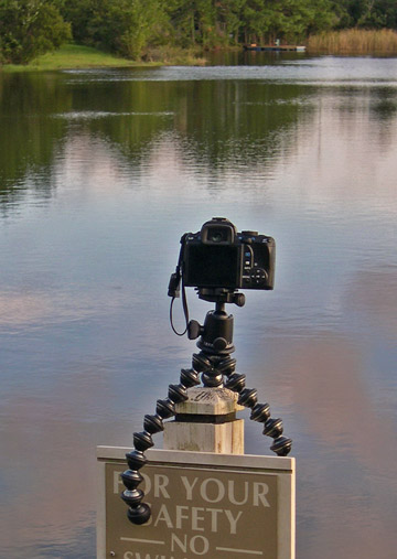 Image of Joby GorillaPod Focus and Ballhead X attached to sign post at lake during sunset by Marla Meier.