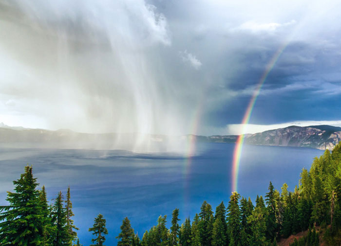 Photo of storm and double rainbow at Crater Lake National Park, Oregon by Duke Miller