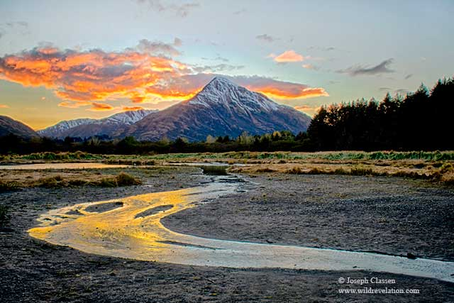 Autumn sunset of mountains and the Buskin River of Kodiak Island, Alaska by Joseph Classen.