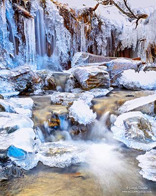 Freezing waterfall and frozen ice and snow on Kodiak Island, Alaska by Joseph Classen