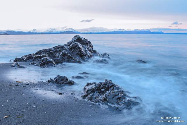 Long exposure captures the rocks and blue crashing waves at Isthmus Bay on Kodiak Island, Alaska by Joseph Classen.