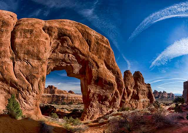 Landscape image of rock formations seen through a rock arche at Arches National Park, Utah by Michael Leggero.