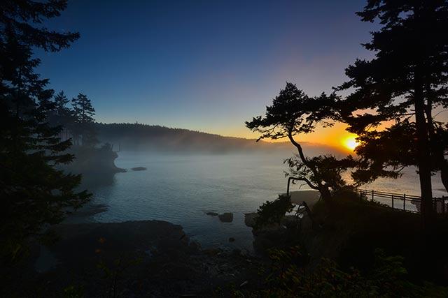 Fog on a lake at sunset at Olympic National Park, Washington by Michael Leggero.