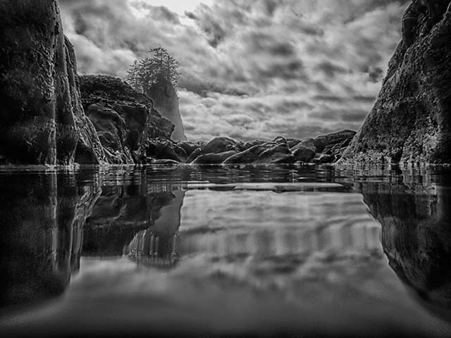 Black and white reflection of rocky cliffs at Olympic National Park, Washington by Michael Leggero.