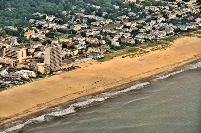 Aerial photo of the water, beach and town of Virginia Beach by Allen Moore.