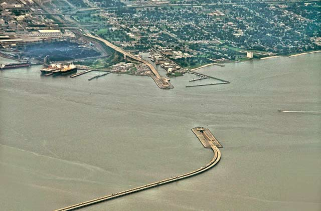 Aerial photo of the James River where the underwater tunnel disappears under the water in Norfolk, Virginia by Allen Moore.