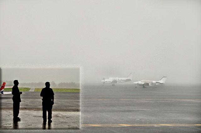 Aerial photography: images of pilots and planes at a fogged-in Chesterfield County Airport by Allen Moore.