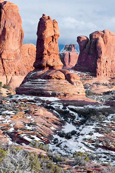 Snow compliments the red rock formations in the Garden of Eden at Arches National Park by Andy Long.