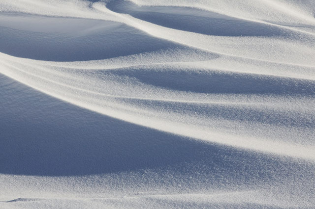 photographing snow. Close-up image of a snow field showing shapes and patterns by Andy Long.