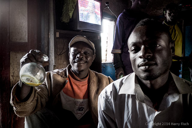 Image of Two Drinkers in a Bar - Dorze Village, Ethiopia by Harry Fisch.