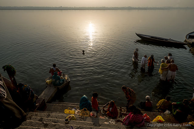 People near and in the river at Varanasi, India for prayers and a sacred bath by Harry Fisch.