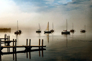 Image of boat dock and sailboats on a foggy morning by James Gordon Patterson.