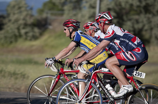 Photo of 3 bicycle racers moving on their bikes by Brad Sharp.