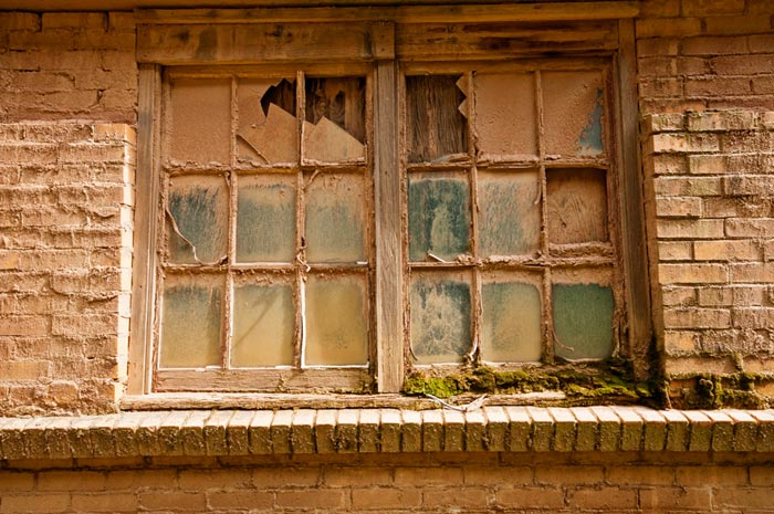Photo of dust covered windows at the Gladding, McBean Terra Cotta Factory by Robert Hitchman