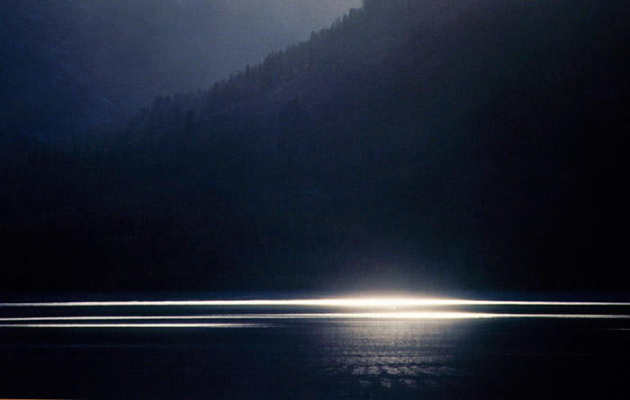 Photo of light on the water of Jackson Lake, Grand Teton National Park, Wyoming by Noella Ballenger