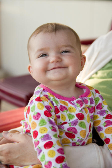 Image of Baby A with a big grin on her face by Elizabeth Powis Fulks.