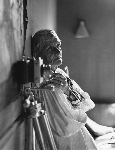 "dying camera - Dorothea Lange in her Bay Area home studio, 1964, as seen in ""American Masters – Dorothea Lange: Grab a Hunk of Lightning."" Photo Credit: ©1964, 2014 Rondal Partridge Archives"