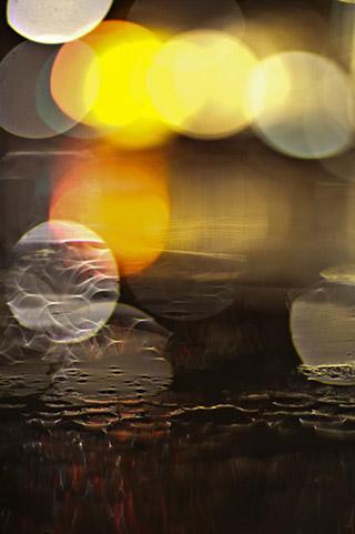 Abstract close-up image of circles of light by Eva Polak.