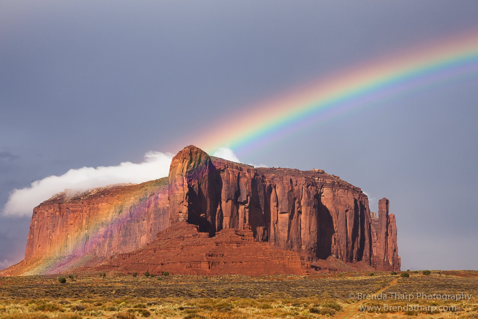 Rainbow, cloud and red rock butte, Utah.