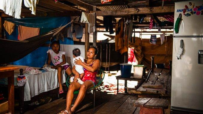 woman nurses child in Belen a district of Iquitos a town in the heart of the Peruvian Amazon