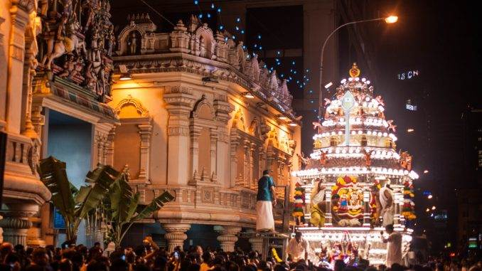 At midnight, thousands of worshippers gather on Petaling Street at the Sri Mahamariamman Temple in KL Chinatown