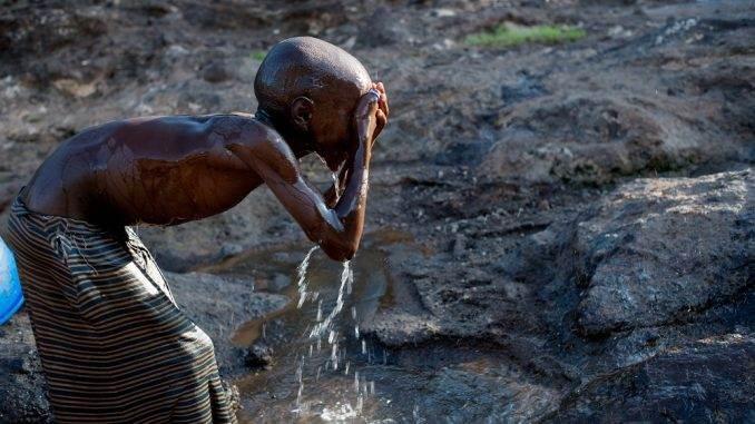 Masai child washing