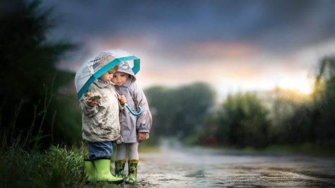 two small children in the rain