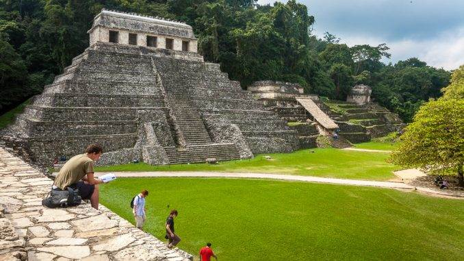 Travelers exploring the pyramids in Palenque, Chiapas