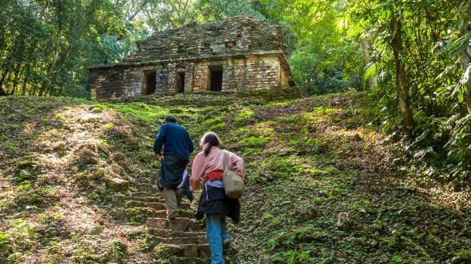 Visitors climbing to one of the temples at Yaxchilan