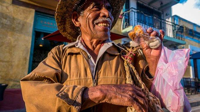 Selling strands of garlic on the streets of San Cristóbal