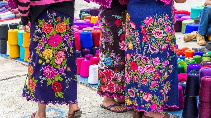 The traditional clothes and textiles of Zinacantan, Chiapas reflect the large flower-growing industry