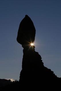 Silhouette photo of a balanced rock