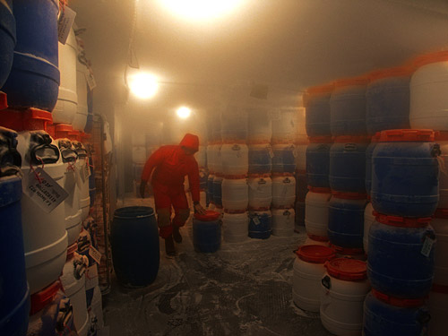 Photo of man working in a cold storage facility by Gert Wagner