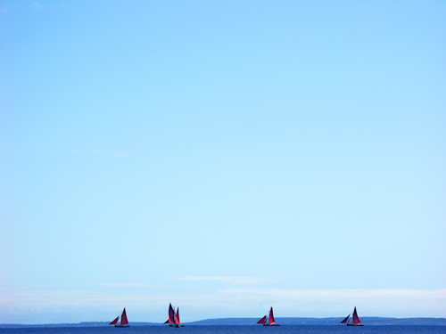 Photo of Galway Hooker sailing vessels at Connemara in Western Ireland by Gert Wagner