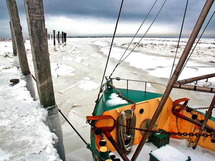 Photo of bow of a trawler along the icy North German coast by Gert Wagner