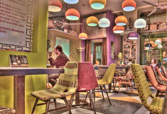 HDR Photography: cafe with colorful interior using high dynamic range / tonal mapping by Matthew Bamberg.