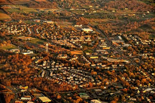 Aerial Photography: Fall landscape photo of a Virginia town with orange, red, and yellow trees by Allen Moore.