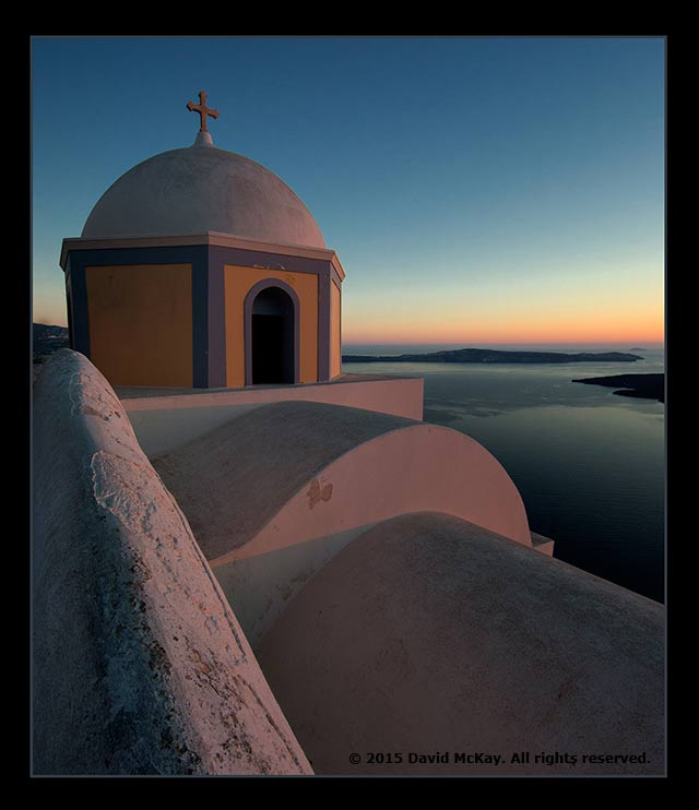 Close-up image of the Santonrini Church with water background at sunrise by David McKay.