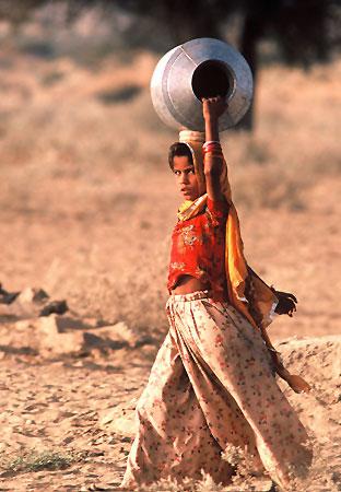 of girl in desert of India by Ron Veto