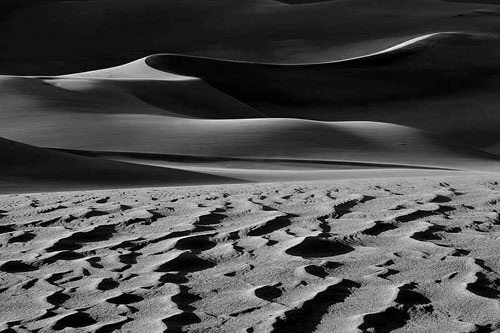 Black and white photo of sand dunes by Andy Long