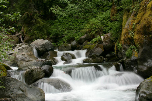 Photo of water rushing over rocks by Andy Long