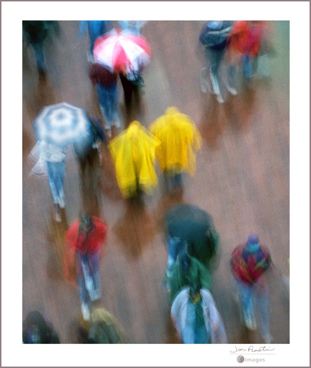 Abstract color photo of people in rain by Jim Austin