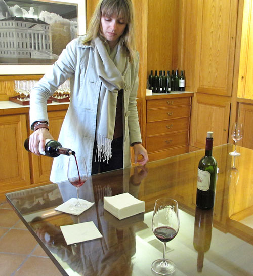 Photo of tour guide pouring a glass of Chateau Margaux in Southern France by Cliff Kolber