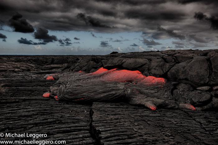 Landscape photo at dusk of hot Kilauea Volcano lava flow in Hawaii by Michael Leggero