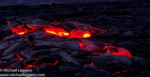 Close-up photo at night of hot Kilauea Volcano lava flow in Hawaii by Michael Leggero