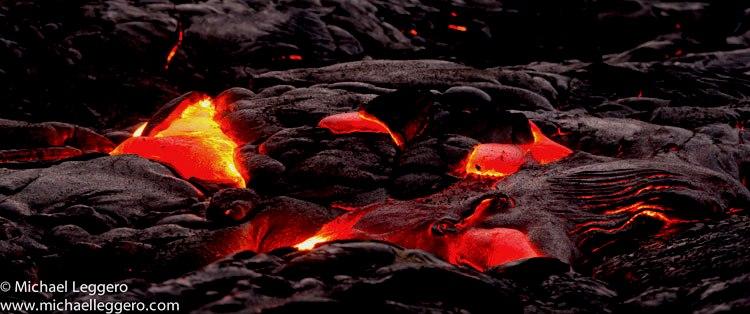 Close-up photo at dusk of hot Kilauea Volcano lava flow in Hawaii by Michael Leggero